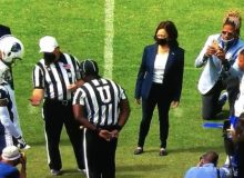 VP Harris Attends College Football Game While Thousands of Illegal Migrants Congregate Under TX Bridge